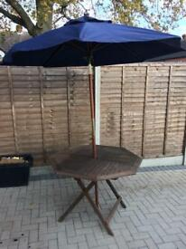 Foldable wooden patio table with parasol