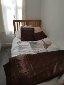 Used single wooden bed