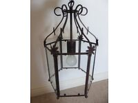 Electric light fitting. Glass lantern light. Metal and glass. Ceiling pendant.