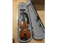 Mint condition rarely used wooden violin with case