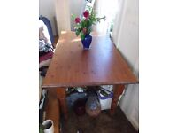 PINE DINING TABLE AND TWO CHAIRS. CAN DELIVER
