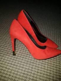 Shoe box red heels