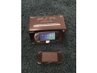 PSP console with 6 games