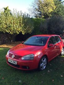 Red Volkswagon Golf GT TDi