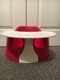 Two red bumbo seats