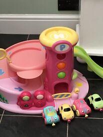 Elc pink whizz around car garage with cars