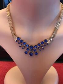 Brand new in box necklace, earrings, ring and bracelet