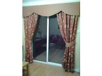 Tailored curtains, tie backs and padded pelmet