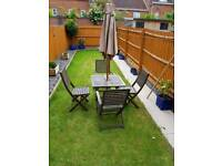 Garden wooden table and chairs with parasol