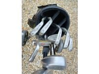 Full set golf clubs and trolley