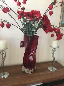Beautiful red vase with flowers