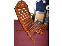 Decorative carved two piece deckchair