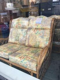 Lovely cane sofa two armchairs & table