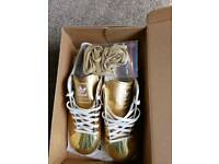 Gold Adidas trainers size 7