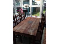 Dinning table and 6 chairs in lovely condition and solid wood