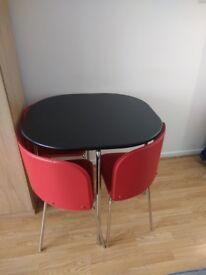 Table and chairs excelllent condition