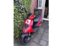 Red piaggio moped great runner 50cc