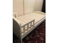 Toddler bed with mattress.