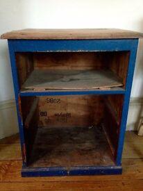 Distressed wooden shelf unit