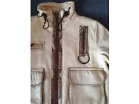 Leather kid's unisex jacket. Condition as new.
