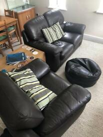 Brown leather sofa suite - two seater and arm chair.