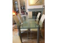 Six seater glass table with 6 chairs preloved