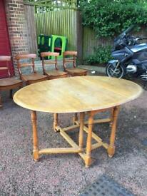 Antique folding dining table and chairs