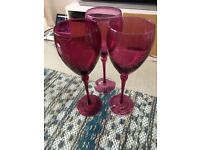 3 purple wine glasses