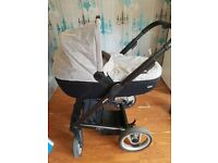 Lovely 2-1 pram with carry cot and rain cover and changing bag