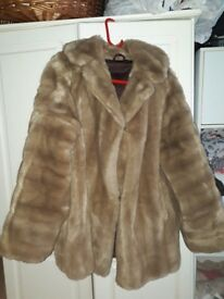 Womans fake fur coat size medium