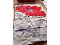 Red poppy rug from next