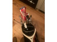Full set of golf clubs taylormade m2 irons, callaway driver, hybrid and putter