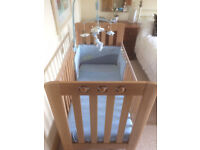 Rennes Playbead natural wood dropside cot with JoJo Maman bedding.