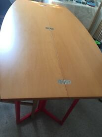 Space saving folding table