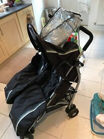 Double buggy with raincover and foot muffs included