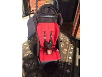 Phil & Teds Dot double buggy with rain over and second seat