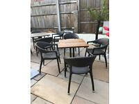 4 Rattan chairs and solid wood table