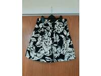 Womens black and white A-line with pleats and bow short skirt