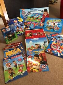 selection of paw patrol toys and books in excellent condition.