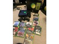 Boxed original Xbox with games