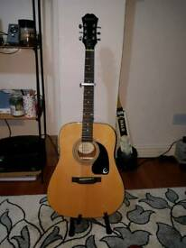 Accoustic guitar with free bag and stand