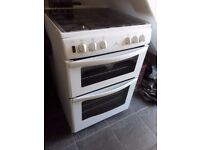 gas cooker, new world 60cm double oven,glass safety lid,spotless inside and out,not very old.