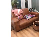 Two seater leather DFS sofa.