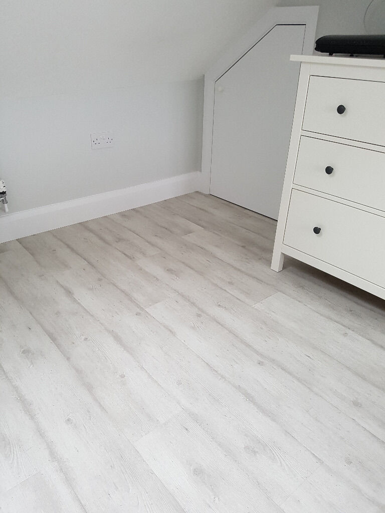 Quickstep Perspective Wood Effect Laminate Flooring Grey