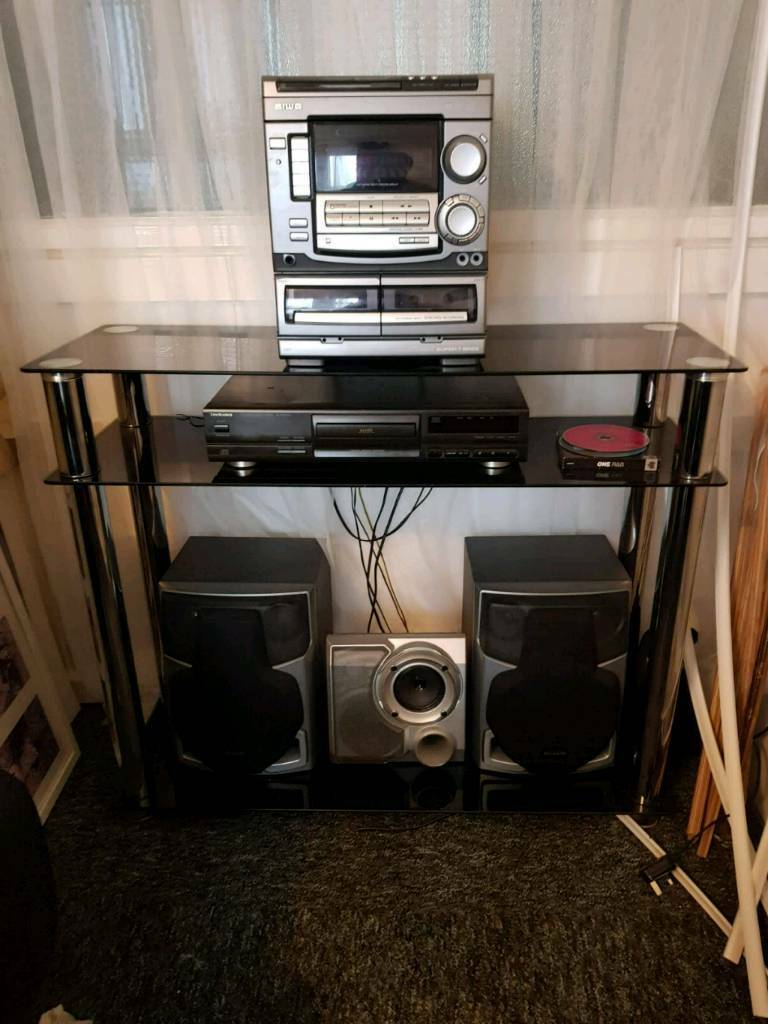 black glass stereo display unit with matching side table
