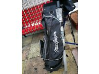 Golf trolley, several clubs including sand wedge new putter 12 golf ball weatherproof trousers