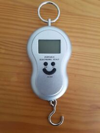 Portable electronic luggage scale - measures in lb, oz & kg