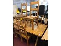 wood table and 6 wood chairs