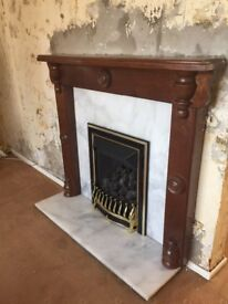 Gas fire, marble hearth and wood surround