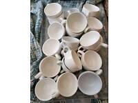 Job lot of earthenware coffee cups